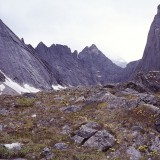 The Arrigetch Peaks were formed by metamorphism of crystalline igneous rock and are characterised by high, rugged relief and an alpine environment. Central Brooks Range, Gates of the Arctic National Park.