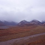 Clearing storm over a braided river system viewed from Polychrome Pass. Braided rivers have unstable channels and are subject to seasonal flooding after ice thaw and rain storms. Denali National Park.