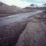 Rockflour flowing into a glacial outwash plane. Wrangell St. Elias National Park.
