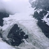 Hanging glacier viewed from the upper reaches of the Twaharpies Glacier, Wrangell St. Elias National Park.
