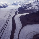 Tributaries of the Kahiltna Glacier forming medial moraines composed predominantly of frost fractured rock. Alaska Range.