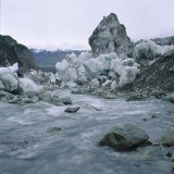Stranded ice following an outburst flood, or jokulhlaup, occurs when ice dammed water bodies drain suddenly, usually under the glaciers. These floods are commonly much larger than storm induced floods and consequently are more devastating in their downstream effects. Hidden Creek Lake, Kennicott Glacier, Wrangell St. Elias National Park.