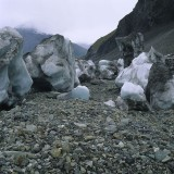 Stranded ice along the western margin of the Kennicott Glacier following the release of impounded meltwater beneath the glacier. The resulting floods are commonly much larger than storm induced floods and consequently are more devastating in their downstream effects. Hidden Creek Lake, Wrangell St. Elias National Park.