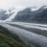 Generating icefall of the West Fork Glacier originating from several small interconnected accumulation areas from the southern flanks of Mount Regal, depicting wave ogives and medial moraines, (August 2011). Wrangell Mountains.